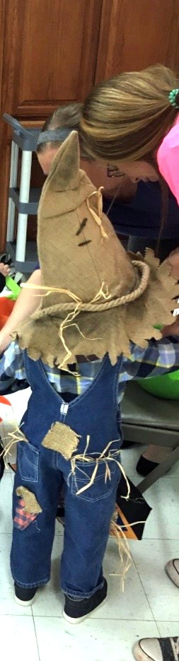 Easy DIY scarecrow costume. Only a few materials needed, a lot of what you probably already have around the house.